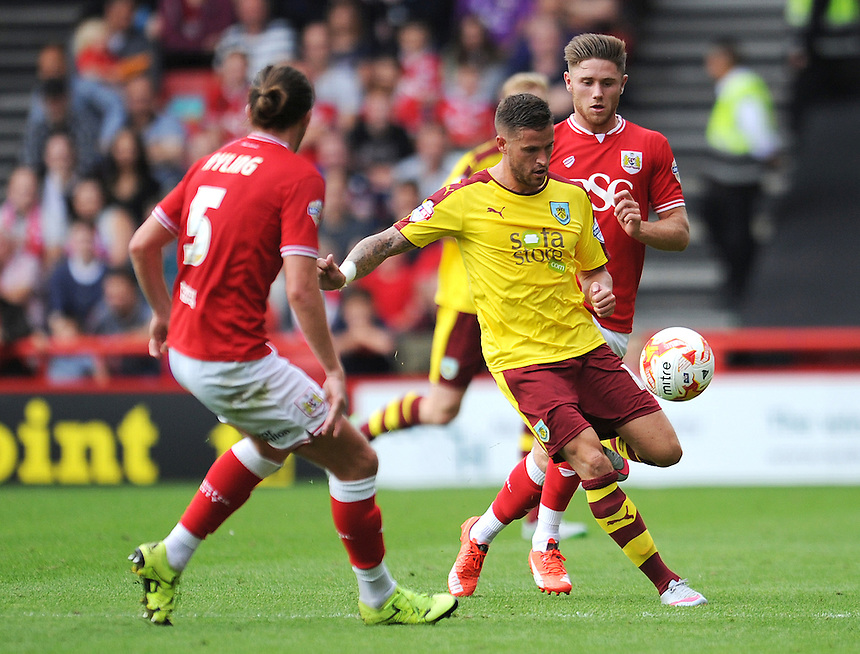 Burnley's Michael Kightly under pressure from Bristol City's Luke Ayling<br /> <br /> Photographer Kevin Barnes/CameraSport<br /> <br /> Football - The Football League Sky Bet Championship - Bristol City v Burnley - Saturday 29th August 2015 - Ashton Gate - Bristol<br /> <br /> &copy; CameraSport - 43 Linden Ave. Countesthorpe. Leicester. England. LE8 5PG - Tel: +44 (0) 116 277 4147 - admin@camerasport.com - www.camerasport.com