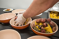 NWA Democrat-Gazette/ANTHONY REYES &bull; @NWATONYR<br /> Prepping bowls of potatoes, corn shiitakes, house made andouille and artichokes at a crawfish boil Wednesday, April 15, 2015 at The Hive, inside the 21C hotel in Bentonville. Many boils happen this time of year. The Hive's boil featured a four course meal with crawfish flown in fresh from the gulf coast. Chef Matt McClure created each dish.