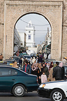 Tripoli, Libya.  Entrance to the medina, Turkish clock tower in background.