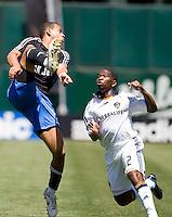 San Jose's Jason Hernandez (21) kicks over LA's Mike Randolph (2). San Jose Earthquakes defeated LA Galaxy 3-2. August 3, 2008, McAfee Coliseum, Oakland, CA.