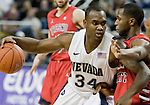 January 21, 2012:   Nevada Wolf Pack guard Malik Story drives past Fresno State Bulldogs guard Garrett Johnson in the first half during their NCAA game played at Lawlor Events Center in Reno, NV.