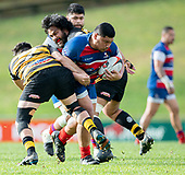 Sesimani Tupou punches though between Mitchell Thackham and Francis Masoe. Counties Manukau Premier 1 McNamara Cup Final between Ardmore Marist and Bombay, played at Navigation Homes Stadium on Saturday July 20th 2019.<br />  Bombay won the McNamara Cup for the 5th time in 6 years, 33 - 18 after leading 14 - 10 at halftime.<br /> Photo by Richard Spranger.