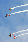 A pair of stunt planes in Team RV to a loop during the Rotary festival Saturday at the Lycoming County Fairgrounds.