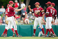 STANFORD, CA - April 23, 2011: Scott Snodgress of Stanford baseball gets a fist bump from Kenny Diekroeger during Stanford's game against UCLA at Sunken Diamond. Stanford won 5-4