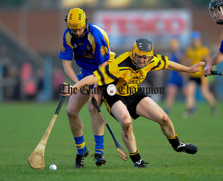Newmarket's Alan Barrett and Clonlara's Pat O hare battle it out during their Senior county final at Cusack Park. Photograph by John Kelly.