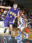 Texas-Arlington Mavericks guard Bryant Smith (24) dribbles around Hardin-Simmons Cowboys guard John Derr (4) in the game between the UTA Mavericks and the Hardin-Simmons Cowboys held at the University of Texas in Arlington's Texas Hall in Arlington, Texas. UTA defeats Hardin-Simmons 88 to 71.
