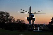 Marine One carrying United States President Donald J. Trump lands on the South Lawn of the White House as Trump returns from visiting wounded service members at Walter Reed Military Hospital on December 21st, 2017 in Washington, D.C. Credit: Alex Edelman / CNP