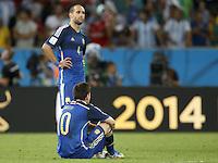 Lionel Messi and Pablo Zabaleta of Argentina look dejected
