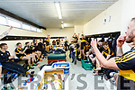 Dr. Crokes Mascot Stephen Brosnan lifts the Bishop Moynihan cup at the team celebrate in their dressing room after winning the Kerry County Senior Club Football Championship Final match between Dr Crokes and Dingle at Austin Stack Park in Tralee, Kerry on Sunday.
