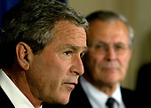 United States President George W. Bush, left, speaks as United States Secretary of Defense Donald Rumsfeld, right, listens after a classified briefing at the Pentagon May 10, 2004.  Bush's trip to the Pentagon was scheduled before the Abu Ghraib prisoner abuse scandal made headlines. <br /> Credit: Mark Wilson / Pool via CNP