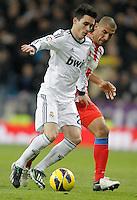 Real Madrid's Jose Callejon against Atletico de Madrid's Cata Diaz during La Liga Match. December 02, 2012. (ALTERPHOTOS/Alvaro Hernandez)