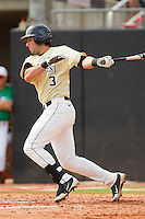 Carlos Lopez #3 of the Wake Forest Demon Deacons follows through on his swing against the North Carolina State Wolfpack at Doak Field at Dail Park on March 17, 2012 in Raleigh, North Carolina.  The Wolfpack defeated the Demon Deacons 6-2.  (Brian Westerholt/Four Seam Images)