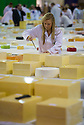 29/07/14 <br /> <br /> Cheese Judge, Emily Oldfield, 22, tastes a cheese at the World's largest cheese show in Nantwich, Cheshire, where 4,443 cheeses, from 26 Countries are competing for glory.<br /> <br /> All Rights Reserved - F Stop Press.  www.fstoppress.com. Tel: +44 (0)1335 300098