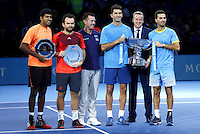 Rohan Bopanna of India and Florin Mergea of Romania stand with Jean-Julien Rojer of Netherlands and Horia Tecau of Romania with their doubles trophies at the ATP World Tour Finals, The O2, London, 2015