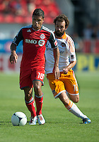 28 July 2012:Toronto FC forward Quincy Amarikwa #18 and Houston Dynamo midfielder Adam Moffat #16 in action during an MLS game between Toronto FC and the Houston Dynamo at BMO Field in Toronto,Ontario Canada...