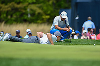 Matt Fitzpatrick (ENG) lies on the green to line up his putt on 11 during round 4 of the 2019 PGA Championship, Bethpage Black Golf Course, New York, New York,  USA. 5/19/2019.<br /> Picture: Golffile | Ken Murray<br /> <br /> <br /> All photo usage must carry mandatory copyright credit (© Golffile | Ken Murray)