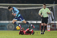 Joe Jacobson of Wycombe Wanderers  rides a tackle during the Sky Bet League 2 match between Wycombe Wanderers and Leyton Orient at Adams Park, High Wycombe, England on 17 December 2016. Photo by David Horn / PRiME Media Images.