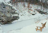 Wooden bench for two overlooking grindstone creek and the facing bluffs in winter season