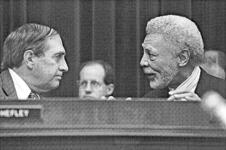 Rep. Ron Dellums, D-Calif. talking with Rep. Joel Hefley, R-Colo. October 23, 1997. (Photo by Shana Raab/CQ Roll Call Call via Getty Images)