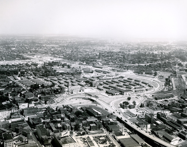 1956 September 10..Redevelopment.Tidewater Gardens (6-2 & 6-9).Downtown East (R-18)..Civic Center (before).Aerial view of Civic Center site prior to construction.Tidewater Gardens in background..PHOTO CRAFTSMEN INC..NEG# 29-956.NRHA# 945..
