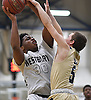 Darius Young #30 of Westbury, left, looks to drive to the net as Matt Trepeta #5 of Baldwin contests his shot during the Nassau County varsity boys basketball Class AA semifinals at SUNY Old Westbury on Tuesday, Feb. 28, 2017. Westbury won by a score of 48-45.
