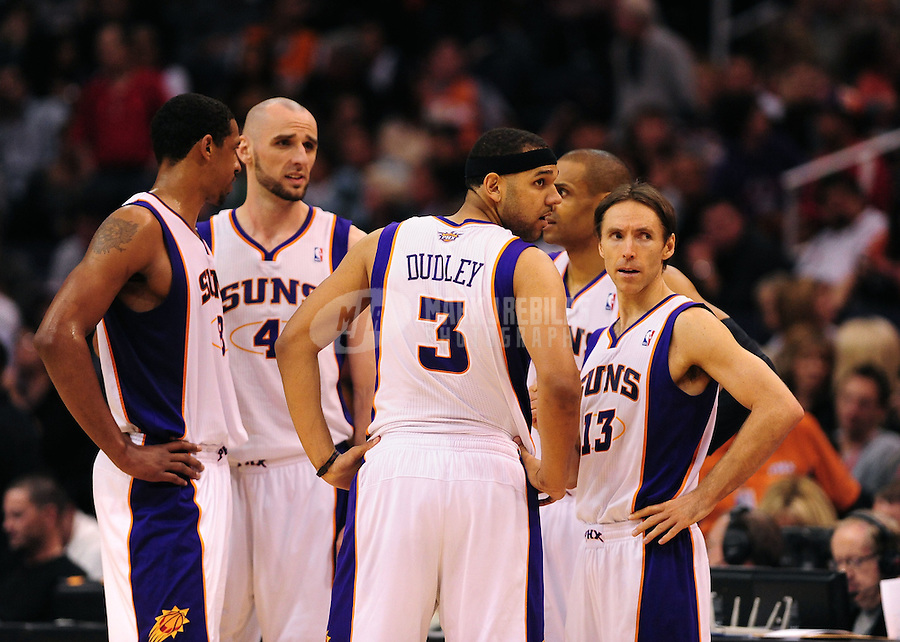 Mar. 2, 2012; Phoenix, AZ, USA; Phoenix Suns players (from left) Channing Frye , Marcin Gortat , Jared Dudley , Grant Hill and Steve Nash in the huddle during game against the Los Angeles Clippers at the US Airways Center. The Suns defeated the Clippers 81-78. Mandatory Credit: Mark J. Rebilas-USA TODAY Sports