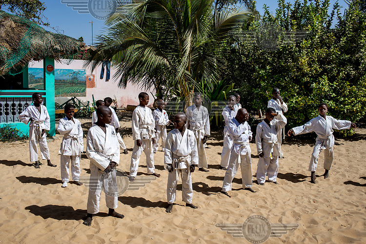 Children during a martial arts session at the Maison de la Gare, a charity that seeks to rehabilitate ex-Talibe (children who live and study the Koran at a Daara, religious school). <br /> Talibe often have issues that stem from being separated from their parents at a young age and the abuse they endure at the Daaras where they are expected to beg to raise money for the Daara's marabout and to get food to fed themselves.