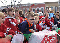 STAFF PHOTO BEN GOFF  @NWABenGoff -- 12/13/14 Children from NWA Youth Hockey ride on a float during the Bentonville Christmas parade through downtown on Saturday Dec. 13, 2014.