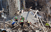 Operators of the Italian Alpine rescue service work on rubble of collapsed buildings in the village of Amatrice, central Italy, hit by a magnitude 6 earthquake at 3,36 am, 24 August 2016.<br /> Operatori del Soccorso Alpino al lavoro tra le macerie degli edifici crollati dopo il terremoto che alle 3,36 del mattino ha colpito Amatrice, 24 agosto 2016.<br /> UPDATE IMAGES PRESS/Riccardo De Luca