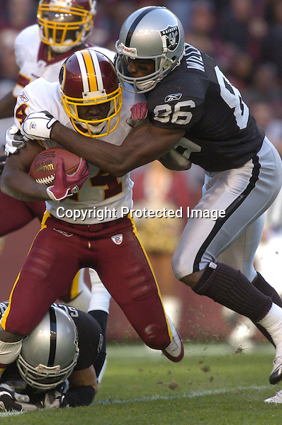 20 November 2005: Randal Williams (86) tackles Rich Parson (14)..The Oakland Raiders defeated the Washington Redskins 16-13  at FedEx Field in Landover, MD.