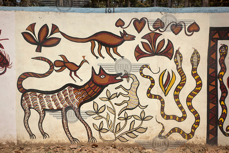 A series of murals painted by the Tribal Women's Artist Collective from Hazaribagh. The collective attempts to keep tribal artistic traditions alive in the face of population displacement from tribal areas due to the spread of mining and the conflict between the India army and Maoist guerillas. Traditionally these painting, known as Sohrai and Khovar, are applied on mud walled village houses during the harvest and wedding seasons (autumn and spring) but as fewer mud houses are being built and the tradition is become rarer, the artist's collective has started painting them in other places such as on this wall along the main North-South highway, bringing the work to the attention of those who would rarely enter tribal areas. The designs and styles are unique to each individual artist and were traditionally passed down from mothers to daughters through the generations. All the paintings however have natural motifs and religious significance reflecting the Adivasi tribe's connection to the natural world and it's significance in their spiritual beliefs..