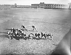 "From the 1930s: Football practice outside of Notre Dame Stadium, 1933.   LE Dom Vairo; LT Edward ""Moose"" Krause; LG Harry Wunseh; G Tom ""Kitty"" Gorman; RG Joe Pivarnik; RT Tom Roach; RE Hugh Devore; QB Tony Mazziotti; RH Ray Brancheau; LH Nick Lukats; FB Steve Banas..Image from the University of Notre Dame Archives."