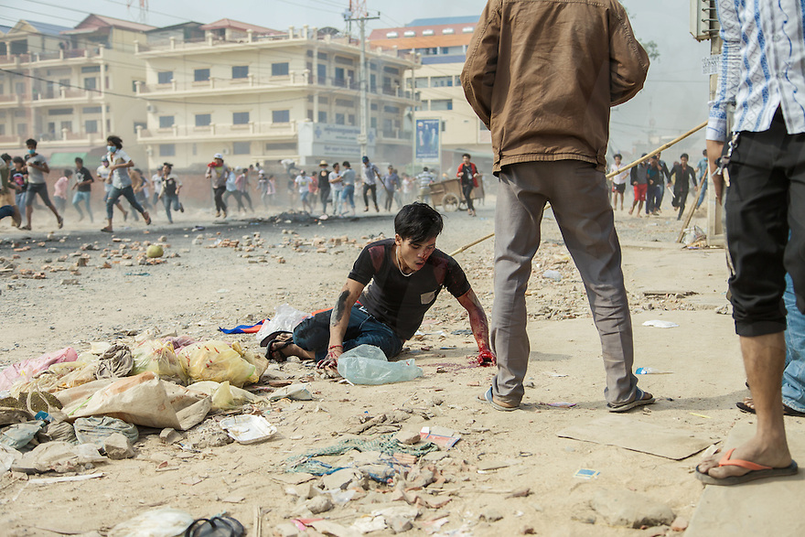 03 January, 2014 - Phnom Penh. A badly wounded man lays on the floor after been hit by a gun shot. © Thomas Cristofoletti / Ruom 2014