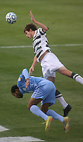 North Carolina's Tyler Duncan (left) and Charlotte's Mikey Lopez (right) battle for the ball during during the NCAA 2011 Men's College Cup in Hoover, AL on Sunday, December 11, 2011.
