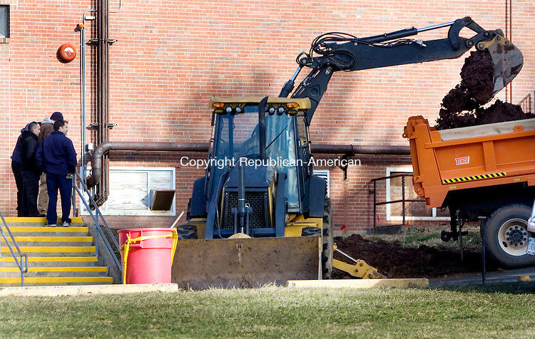 CHESHIRE, CT. 04 January 2012-010412SV02-A crew works to repair a water main break at the High school in Cheshire Tuesday. The school was dismissed at 10:45am due to the break..Steven Valenti Republican-American