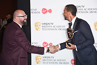 Tom Davis and Rio Ferdinand in the winners room for the BAFTA TV Awards 2018 at the Royal Festival Hall, London, UK. <br /> 13 May  2018<br /> Picture: Steve Vas/Featureflash/SilverHub 0208 004 5359 sales@silverhubmedia.com