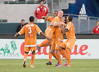 Puerto Rico Islanders Noah Delgado (5) lefts up teammate David Foley (7) after scoring a goal beginning the celebration. The Puerto Rico Islanders defeated the LA Galaxy 4-1 during CONCACAF Champions League group play at Home Depot Center stadium in Carson, California on Tuesday July 27, 2010.Puerto Islanders Alexis Rivera (5)