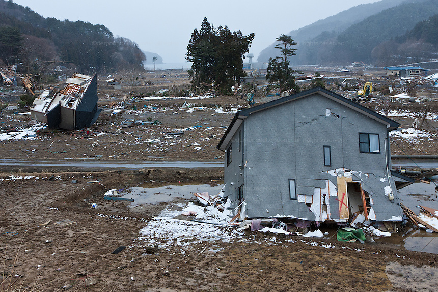 Upturned houses litter a valley after  the tsunami in Kamiarakawa, Iwate, Japan. March 17th 2011