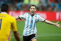 Maxi Rodriguez of Argentina celebrates scoring the winning penalty towards Goalkeeper Sergio Romero