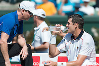 March 6, 2016: Jim Courier captain of the USA team coaches John Isner in the first reverse single match against Bernard Tomic of Australia during of the BNP Paribas Davis Cup World Group first round tie between Australia and USA at Kooyong tennis club in Melbourne, Australia. Photo Sydney Low