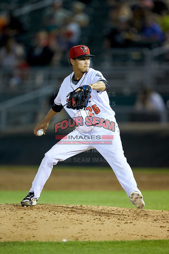 Lansing Lugnuts relief pitcher Emerson Jimenez (26) in action against the South Bend Cubs at Cooley Law School Stadium on June 15, 2018 in Lansing, Michigan. The Lugnuts defeated the Cubs 6-4.  (Brian Westerholt/Four Seam Images)
