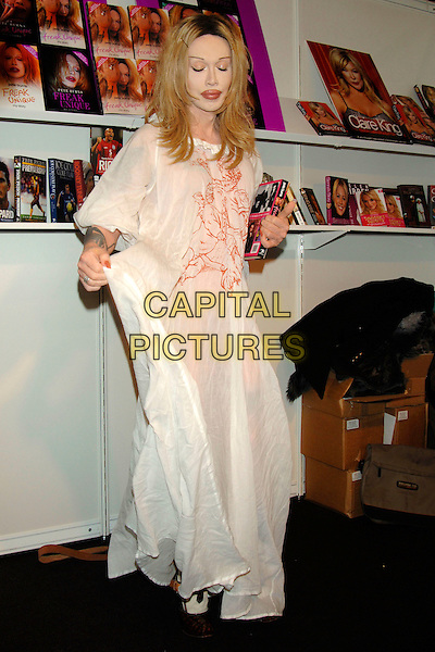 "PETE BURNS.(DEAD OR  ALIVE singer).Promoting his new book ""Freak Unique - My Story"" at the London Book Fair, Excell Centre, London, England, .March 5th 2006..full length long floaty white dress eyes shut.www.capitalpictures.com.sales@capitalpictures.com.©Phil Loftus/Capital Pictures"