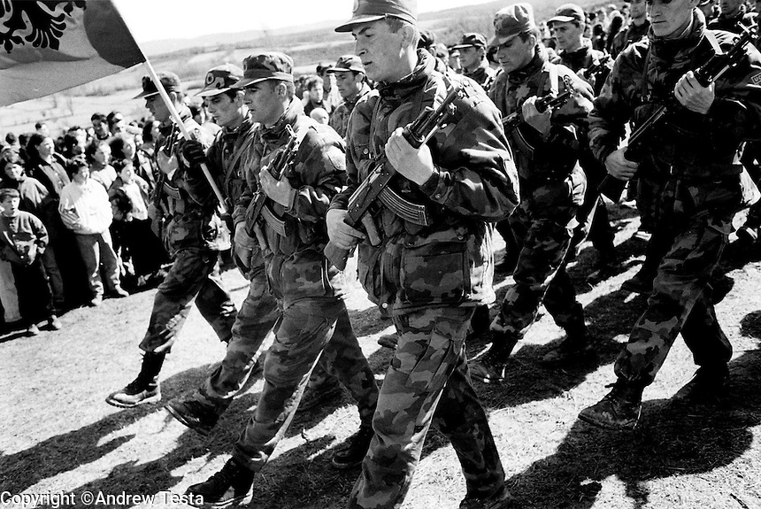KLA unit on parade at a ceremony to mark the firstannivesary of the massacre of KLA leader Adem Jashari and his family at Prekaz. 06/03/99.