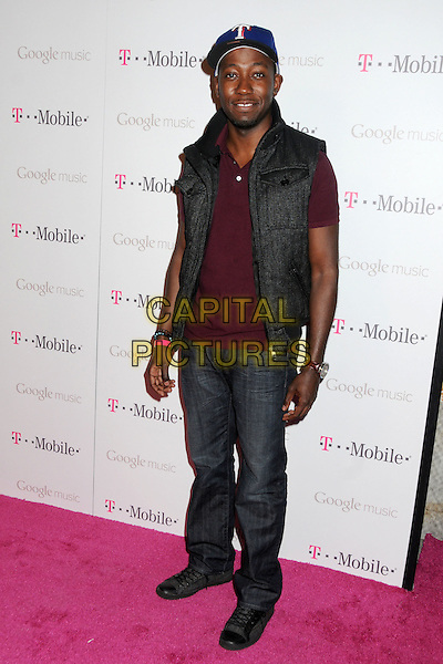 Lamorne Morris.T-Mobile Launch Party For Google Music held at Mr. Brainwash Studio, Hollywood, California, USA..November 16th, 2011.full length black sleeveless jeans denim  grey gray maroon .CAP/ADM/BP.©Byron Purvis/AdMedia/Capital Pictures.