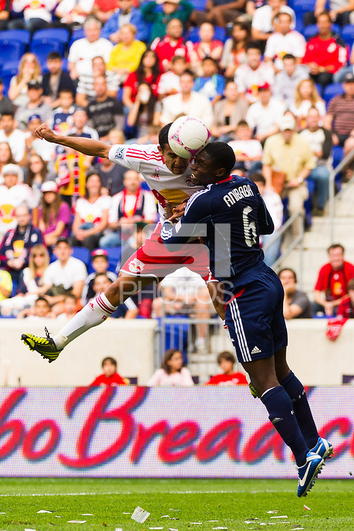 Tim Cahill (17) of the New York Red Bulls goes up for a header with Jalil Anibaba (6) of the Chicago Fire. The Chicago Fire defeated the New York Red Bulls 2-0 during a Major League Soccer (MLS) match at Red Bull Arena in Harrison, NJ, on October 06, 2012.