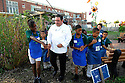 In this photo provided by the Emeril Lagasse Foundation, celebrity chef Emeril Lagasse tours the Edible Schoolyard at Samuel Green Charter School  with students after they cut the ribbon to the new teaching kitchen donated to the school, New Orleans, Tuesday, Oct. 6, 2009..(AP Photo/Cheryl Gerber)