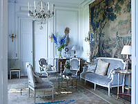 The salon's George Jacob settee and armchairs are upholstered in a letievre velvet, the chest of drawers, barometer clock and aubusson rug are all 18th century and the chandelier and sconces are 19th century
