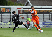 Pictured L-R: Kerry Morgan of Neath tries to block Steven Caulker of Swansea. Saturday 17 July 2011<br /> Re: Pre season friendly, Neath Football Club v Swansea City FC at the Gnoll ground, Neath, south Wales.