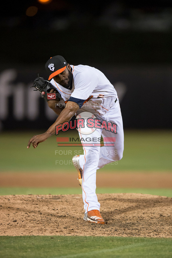 Fresno Grizzlies relief pitcher Reymin Guduan (19) follows through on his delivery during a Pacific Coast League game against the Salt Lake Bees at Chukchansi Park on May 14, 2018 in Fresno, California. Fresno defeated Salt Lake 4-3. (Zachary Lucy/Four Seam Images)