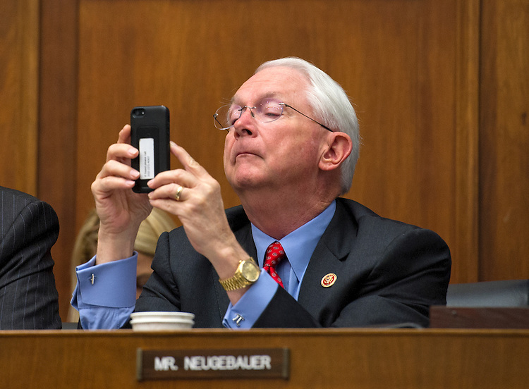 UNITED STATES -July 17: Rep. Randy Neugebauer, R-TX., checks his phone during the House Financial Services Committee hearing on the monetary policy and the state of the economy on July 17, 2013. (Photo By Douglas Graham/CQ Roll Call)